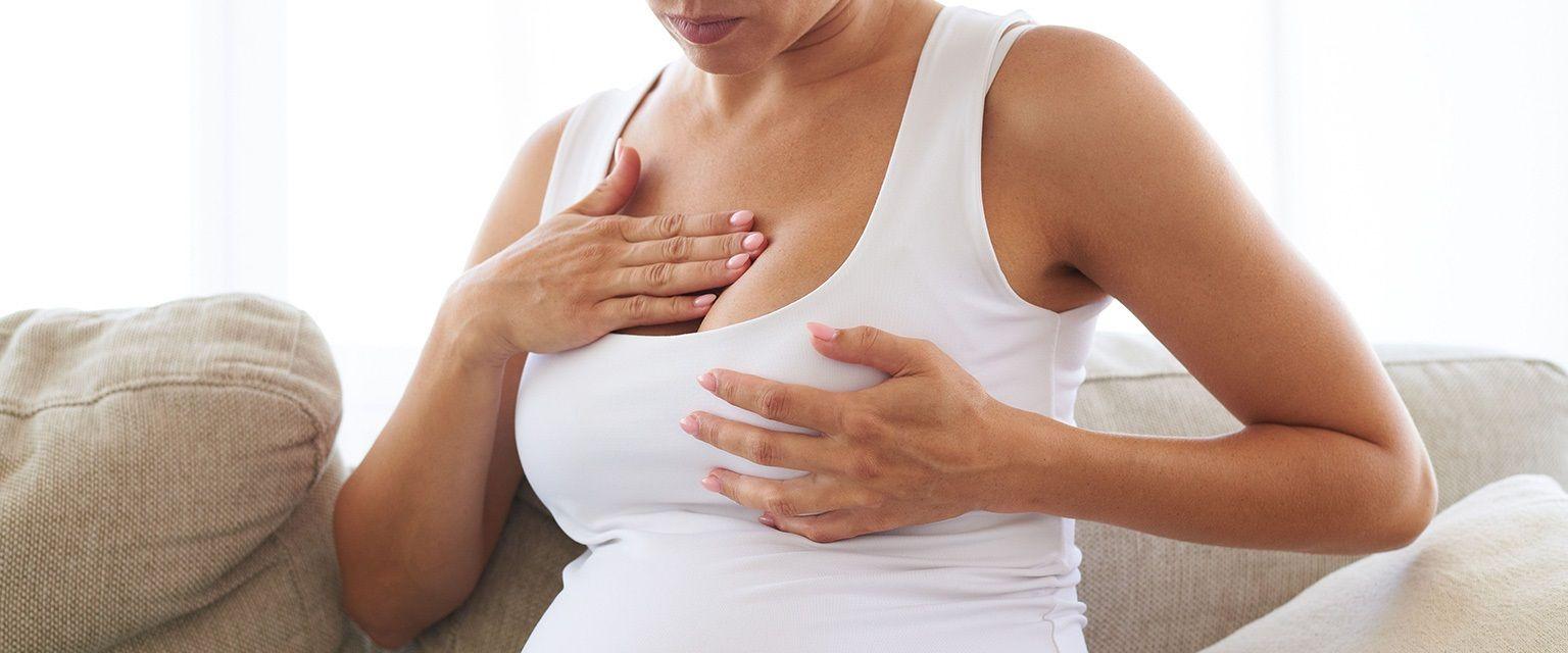 у женщины болит набухшая грудь